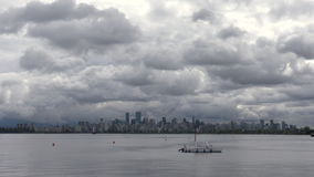 Vancouver Cityscape Cloud Timelapse 4K. UHD. Large, dark clouds rolling across downtown Vancouver. Timelapse. 4K. UHD stock footage