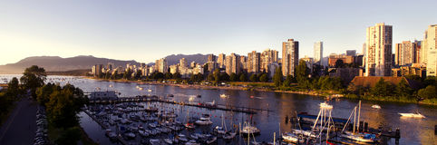 Vancouver Cityscape. Panoramic shot of Vancouver at Sunset looking over the habour Stock Photos