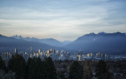 Vancouver Cityscape. A Panoramic view of Vancouver Cityscape with surrounding mountains at Sunset Stock Photo