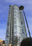 Vancouver Condominium. A tall condominium rises high above Vancouvers waterfront area in the Yaletown Stock Images