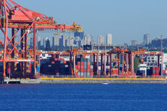 Vancouver container port with huge lifting cranes Royalty Free Stock Images