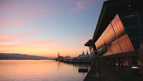 Vancouver Convention Center Reflection. Vancouver's Convention Center and Canada Place on Burrard Inlet at dawn. British Columbia, Canada stock footage