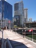 Vancouver Downtown and convention center. Large plaza near Canada Place, the convention center and the harbor in Downtown Vancouver on a sunny day. Few Canadian Royalty Free Stock Photo