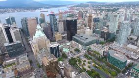 Vancouver downtown financial district big famous modern skyscrapers towers architecture by water in 4k aerial panorama stock video footage