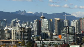 Vancouver downtown skyline. Establishing zoom out Vancouver Canada sunny day stock video footage