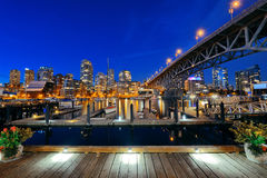 Vancouver False Creek. At night with bridge and boat Royalty Free Stock Photos