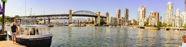 Vancouver False Creek panorama at sunset with bridge and boat. stock image