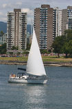 Vancouver fun. Sailboat against Vancouver backdrop Stock Images