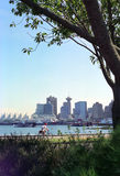 Vancouver Harbor BC Canada. Cyclist enjoys Stanley Park seawall ride Royalty Free Stock Photo
