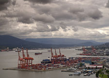 Vancouver harbor with container terminal in the foreground. Royalty Free Stock Photo