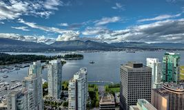 Vancouver Harbour. Aerial view at Vancouver Harbour, Downtown of Vancouver City and North Vancouver on opposit side of Burrard Inlet against the background of a royalty free stock images