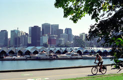 Vancouver Harbour British Columbia Canada. Cyclist enjoys Vancouver's seawall path around Stanley Park stock photography
