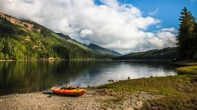 Kayak in Front of Nimpkish Lake. VANCOUVER ISLAND, BC - JULY 3, 2017 - A kayak in front of The Nimpkish Lake on July 3rd, 2017, on Northern Vancouver Island Stock Image