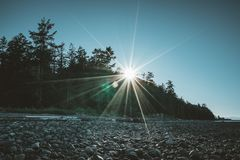 Free Vancouver Island Beach View On A Clear Blue Sky With Sunstar And Pacific Coast. Canada. Stock Image - 121935561