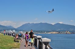People at Stanley Park Seawall Stock Photography
