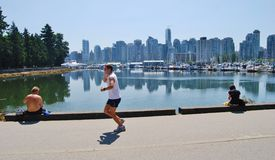 People Active at Vancouver Waterfront Seawall Royalty Free Stock Photography