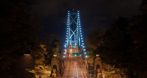 Vancouver Lionsgate Bridge Rush Hour Traffic Timelapse. Vancouver, British Columbia. Canada cars travel over the Lionsgate bridge during rush hour at night stock video footage