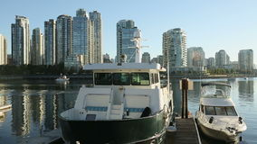 Vancouver Marina, Yaletown View. Looking across False Creek, past boats, at an early morning view of Vancouver's downtown Yaletown neighborhood. British Columbia stock video