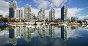 Vancouver modern real estate  architecture harborfront Timelapse. Vancouver, British Columbia Canada water reflections at the Quayside marina of condominium stock footage