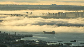 Vancouver Morning Fog, Mount Baker. A high angle view of Vancouver and the Burrard Inlet at sunrise. The Fraser Valley stretches out in the background. British stock footage