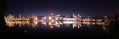 Vancouver Night Panorama. With reflection in a lake royalty free stock photo