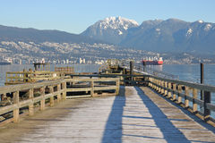 Vancouver Pier and Grouse Mountain Royalty Free Stock Photos