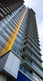 Vancouver Residential Tower. Colorful Residential High Rise Tower in Vancouver, Canada extends towards the sky Stock Photo