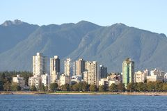 Vancouver's West End Condos and Mountains Royalty Free Stock Photography