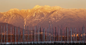 Vancouver Sailboat Masts Golden Snow Mountains BC Royalty Free Stock Images