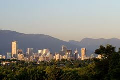 Vancouver Sky Line. A South side view of Vancouver, British Columbia, Canada from above the tree tops during sunset stock photo