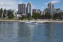 Vancouver skyline. Speed boat in front of Vancouver skyline Stock Images