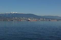 Vancouver skyline. Northern skyline of Canadian city of Vancouver seen across ocean royalty free stock images