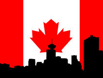 Vancouver skyline. Against Canadian flag Stock Photography