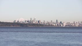 Vancouver Skyline across English Bay 4K UHD. The Vancouver skyline across English Bay. Mount Baker in the background. British Columbia, Canada. 4K. UHD stock video
