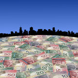 Vancouver skyline with Canadian dollars Royalty Free Stock Photo