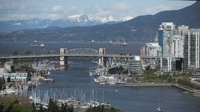 Vancouver Skyline. During daytime with boats on the river stock footage