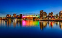 Vancouver skyline on False Creek and BC Place stadium at night i. Vancouver skyline on False Creek and illuminated BC Place stadium at night in British Columbia royalty free stock photo