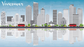 Vancouver skyline with grey buildings, blue sky and reflections. Royalty Free Stock Photo