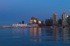 Vancouver skyline at night, British Columbia, Canada. Urban downtown panorama with Canada Place colorful sails along the coastal harbor line royalty free stock photos