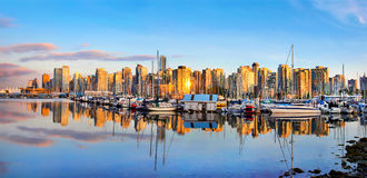 Vancouver skyline panorama at sunset, British Columbia, Canada. Panoramic view of Vancouver skyline at sunset as seen from Stanley Park, British Columbia, Canada Royalty Free Stock Photos