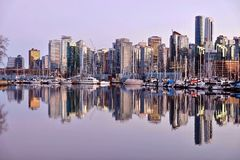 Vancouver skyline and reflection in water. Coal Harbor from Stanley Park. Dowtown Vancouver. British Columbia. Canada Royalty Free Stock Photo