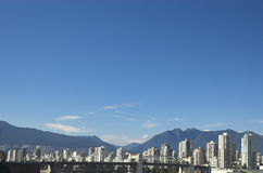 Vancouver skyline with Rocky Mountains. In background Stock Photos