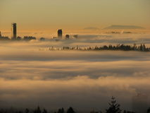 Vancouver skyline at sunset with fog stock photo