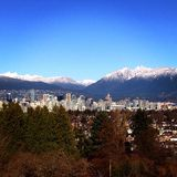 Vancouver skyline. View of downtown Vancouver, Canada nestled in mountains Stock Photo