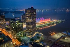 Vancouver Skyline With Canada Place At Night, Aerial View Stock Images