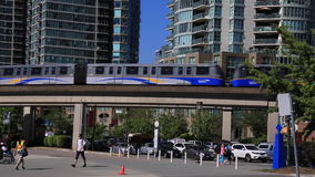 Vancouver skytrain moving people walking. Public transportation urban landscape Vancouver July 2015 stock video