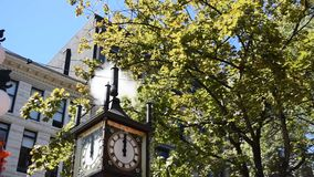 Vancouver Steam Clock. The Steam Clock in Gastown, Vancouver, BC whistles the Westminster Chimes at Noon stock footage