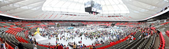 Vancouver Sun Run Festivities inside BC Place. VANCOUVER, CANADA - April 21, 2013 - Participants having just completed the Vancouver Sun Run visit different royalty free stock photos
