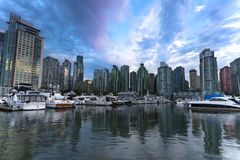 Vancouver Sunset Skyline Cityscape. Beautiful colours light the sky at sunset.  Coal Harbour, Vancouver, BC, Canada Stock Photos