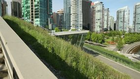 Vancouver Towers, Green Roof. A dolly shot looking over the Vancouver Convention Center's environmentally friendly, 6 acre green roof stock video footage